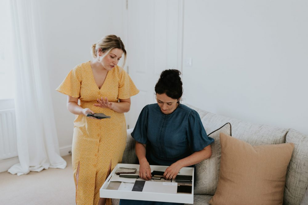 Danielle & Emily Looking at Material Swatches - Wells and Maguire Interior Designers