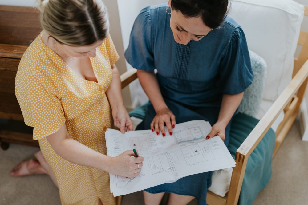 Interior Designer Looking At Room Plans - Wells and Maguire